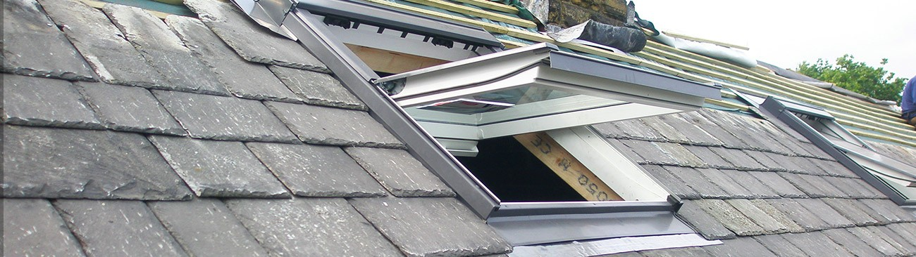 Roof windows in a slate roof