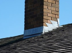 Waterproofing chimneys with flashing